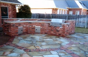 Concrete Contractors Justin TX - Driveways, Patios, Stamped & Decorative - McFall - outdoor-brick-bbq-rock-patio-300x195