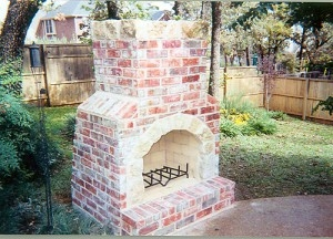 High-Quality Outdoor Kitchens Near Richardson TX - McFall Masonry & Construction - outdoor-short-fireplace-300x216